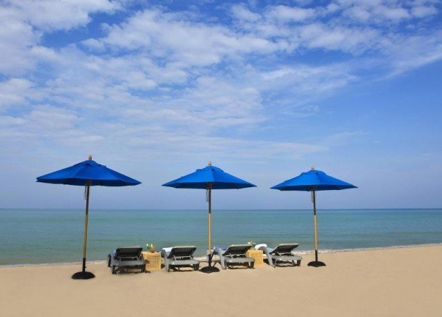 umbrella sky chair Beach blue natural environment Nature Ocean shore Sea couple lawn day shade lined sandy