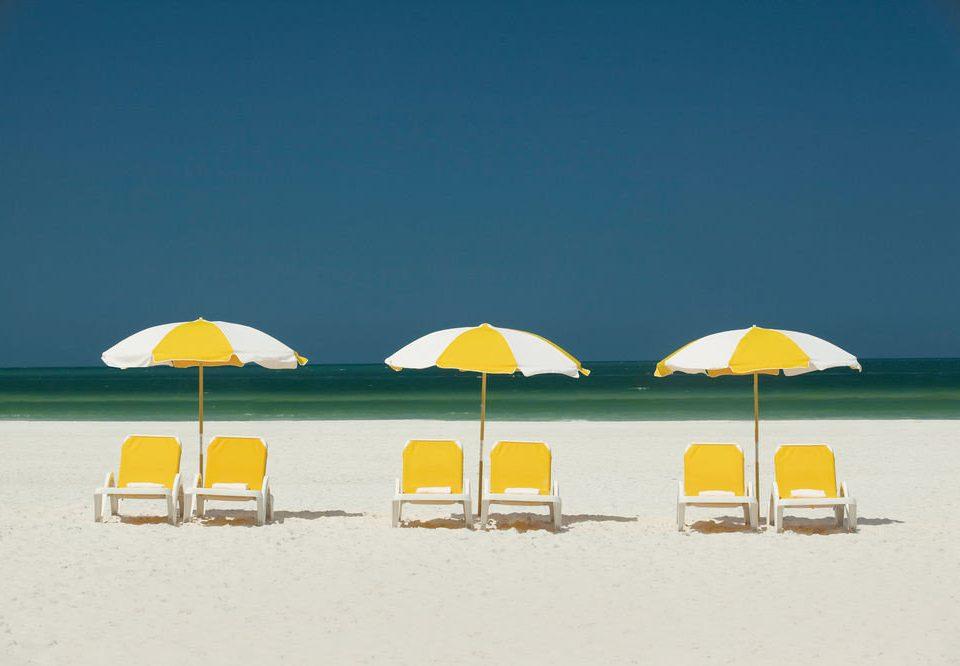 accessory umbrella yellow chair rain Beach Ocean horizon Sea atmosphere of earth fashion accessory Nature sand shore day