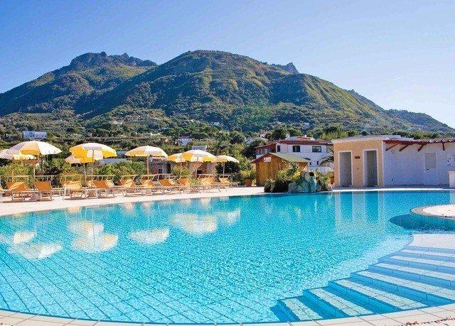 mountain sky swimming pool property Pool Resort Beach leisure Nature Villa resort town swimming blue caribbean shore