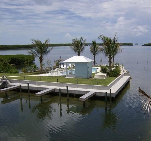 Beach Ocean Outdoor Activities water dock marina house vehicle Sea home waterway Villa shore lined day