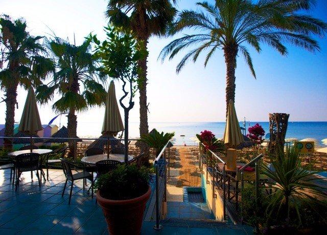 tree sky palm plant Beach property Resort leisure caribbean arecales swimming pool Villa Ocean lined palm family condominium Pool tropics hacienda eco hotel shade sandy
