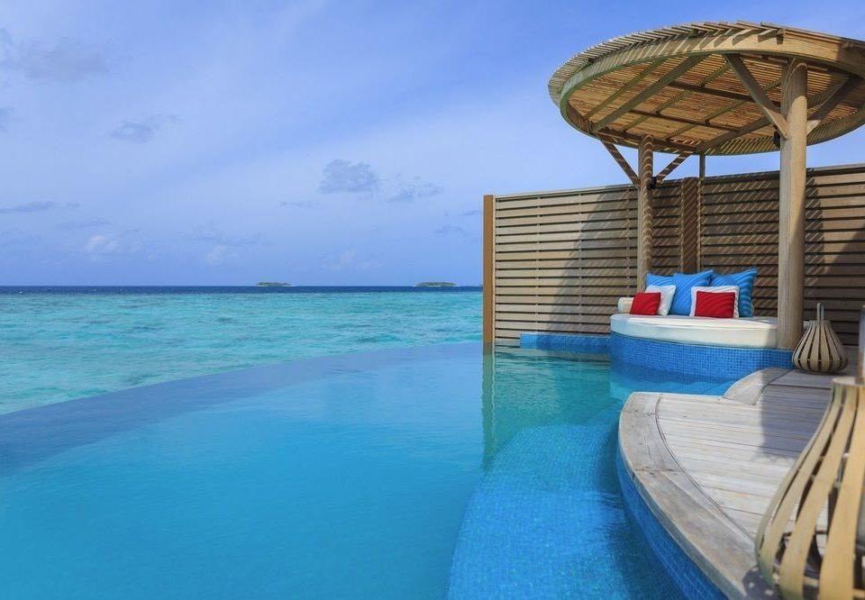 water sky chair umbrella swimming pool leisure Resort Pool caribbean Sea Ocean Beach blue swimming shore