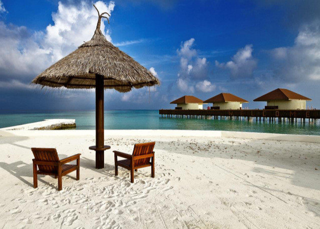 umbrella sky chair water caribbean Beach Resort Sea coastal and oceanic landforms shore lawn tropics Ocean leisure set lined day sandy