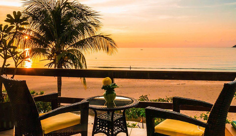 water sky Beach palm Sun Sunset Resort arecales Ocean setting overlooking evening caribbean Sea tree plant shore set