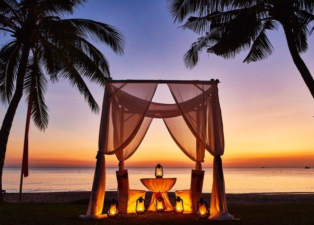 sky water Beach tree Ocean palm Sunset plant arecales evening Sea Resort sunlight sandy shore sailing vessel shade distance