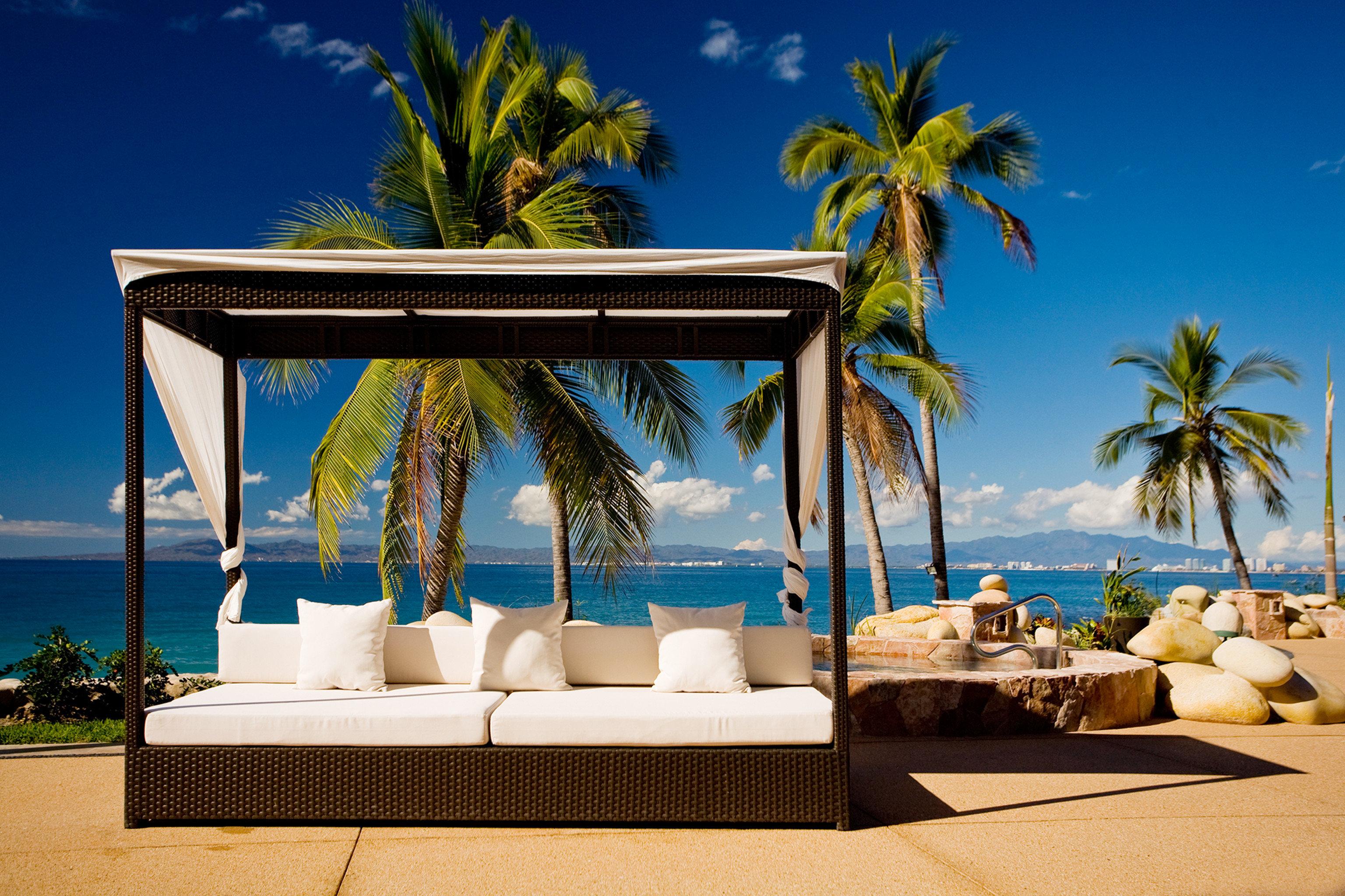 tree palm swimming pool caribbean Resort Beach plant arecales Ocean Villa Sea beautiful shade