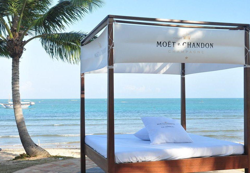 water sky Ocean property leisure swimming pool caribbean Resort shore Beach Villa lawn condominium overlooking day