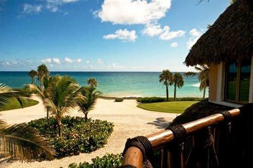 sky water property leisure Resort caribbean Ocean Beach Villa overlooking shore palm