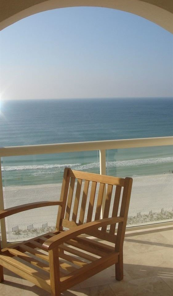chair water sky Ocean property wooden Beach Sea overlooking shore