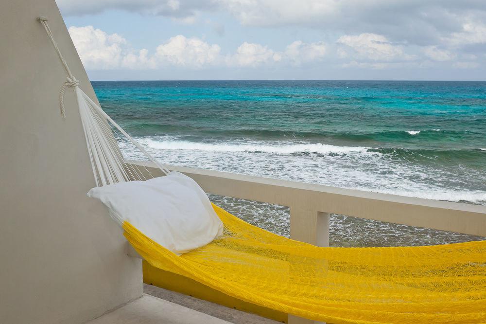 sky water Beach leisure Ocean yellow Sea hammock wave surfing equipment and supplies shore sandy