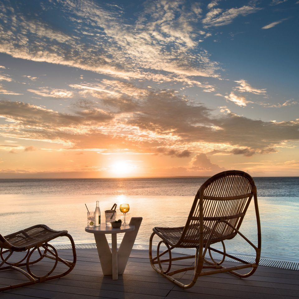 Trip Ideas water sky chair Beach Sea Sunset horizon sunrise Ocean shore cloud morning caribbean evening tropics calm dawn dusk Sun set overlooking sandy