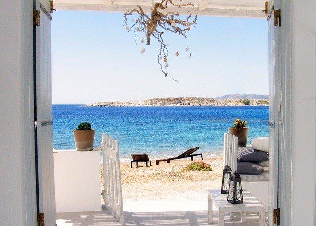 water property Beach Ocean home Villa caribbean cottage condominium overlooking shore day
