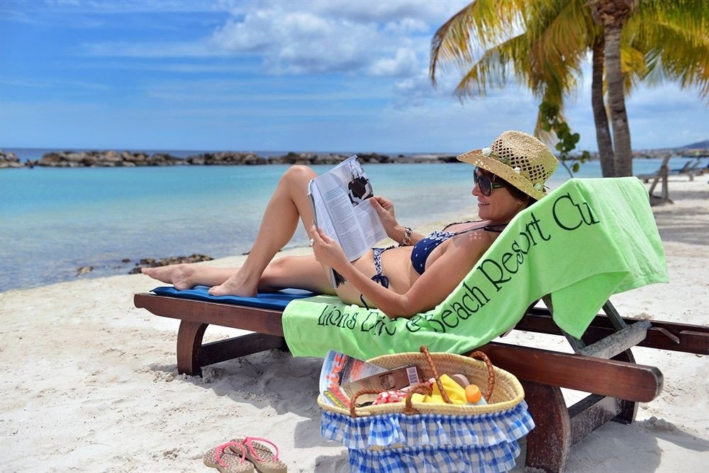 sky ground leisure Beach sun tanning Picnic sitting caribbean Sea swimming pool shore day