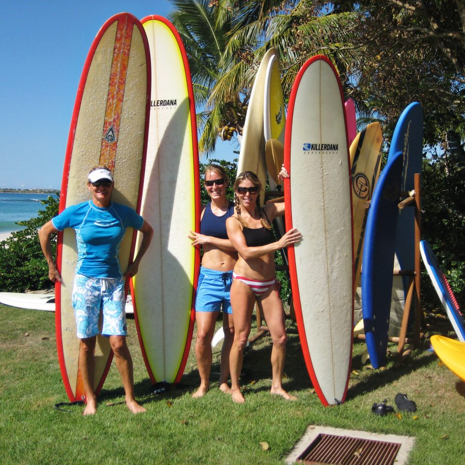 surfing boarding standing leisure Beach young surfboard Play surfing equipment and supplies group sports paddle physical fitness posing outdoor object Playground