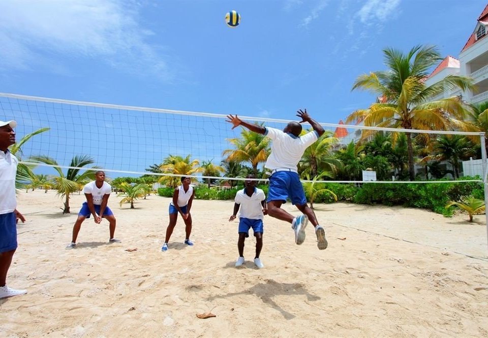 sky ground athletic game Beach Sport ball game sports leisure beach volleyball tennis volleyball Play ball over a net games tournament competition event sand sandy