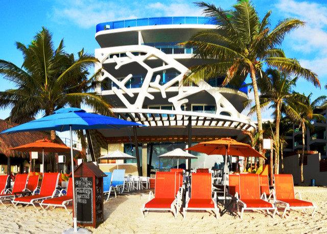 tree sky ground leisure Beach chair Resort amusement park Water park orange caribbean park walkway Playground palm lined