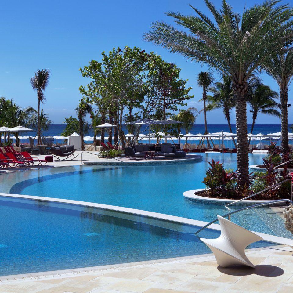 sky tree water swimming pool leisure Resort property palm Pool condominium resort town Beach marina lined arecales caribbean swimming shore