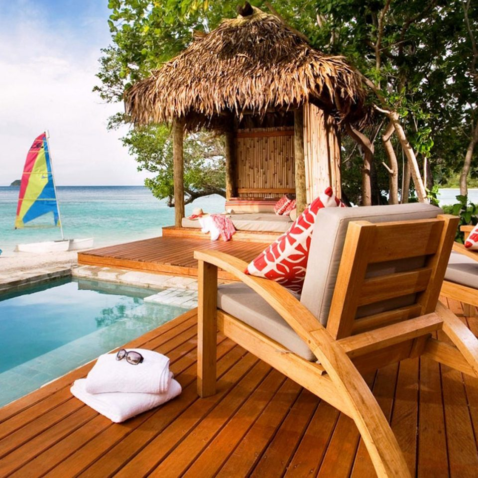Beach Pool Scenic views tree chair leisure property swimming pool Resort Villa wooden cottage backyard