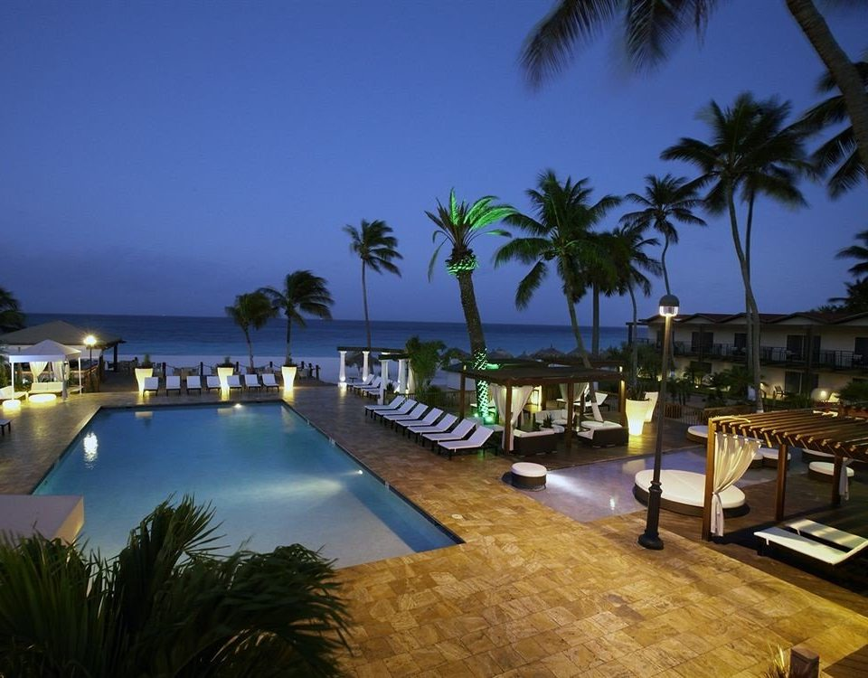 tree palm sky leisure property Beach Resort swimming pool arecales marina Sea Pool condominium Villa lined shore