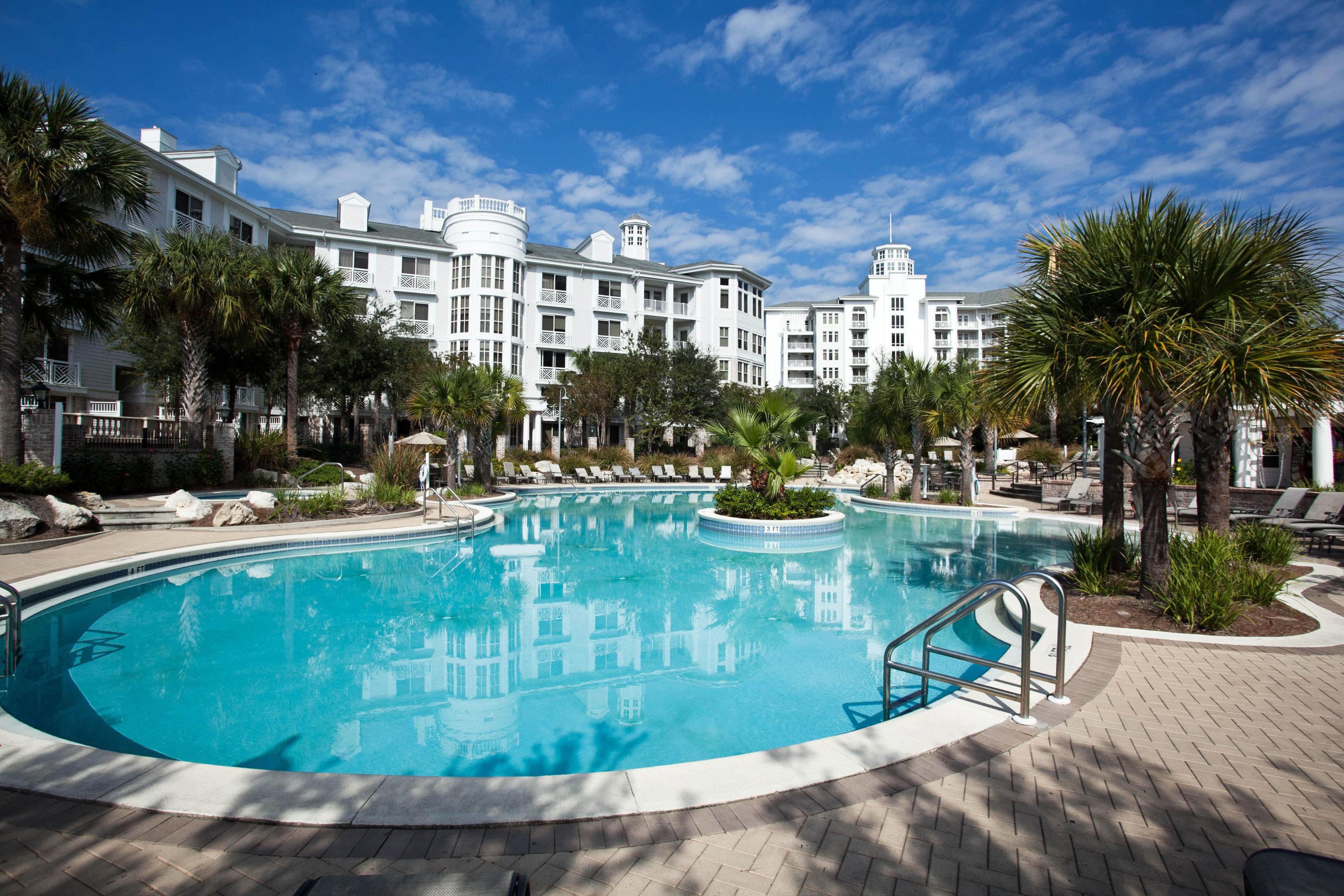 Beach Pool sky ground swimming pool property blue leisure Resort condominium reflecting pool swimming resort town backyard Villa mansion empty