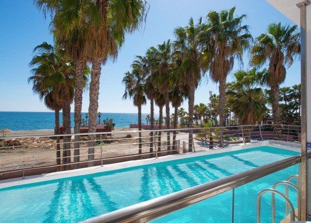 sky tree water Pool Beach Resort palm swimming pool property leisure caribbean water sport condominium Villa resort town arecales swimming lined