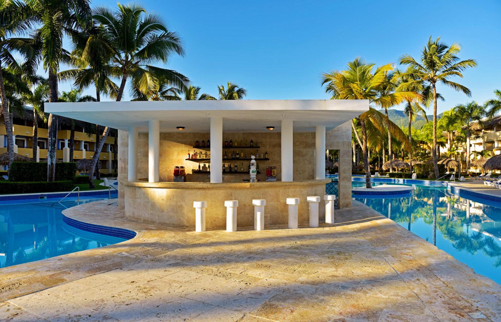 tree Resort Pool swimming pool leisure property blue home resort town Villa mansion palm caribbean condominium Beach swimming