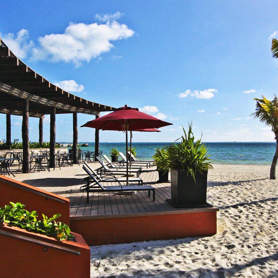 sky umbrella leisure Resort building Beach caribbean Villa Pool palm shade day