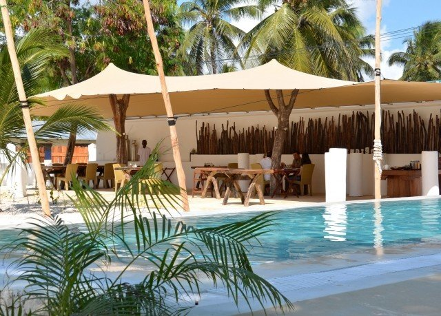 tree umbrella palm leisure swimming pool Resort property Pool caribbean Villa arecales hacienda eco hotel Beach lawn plant Water park lined swimming shore shade sandy day
