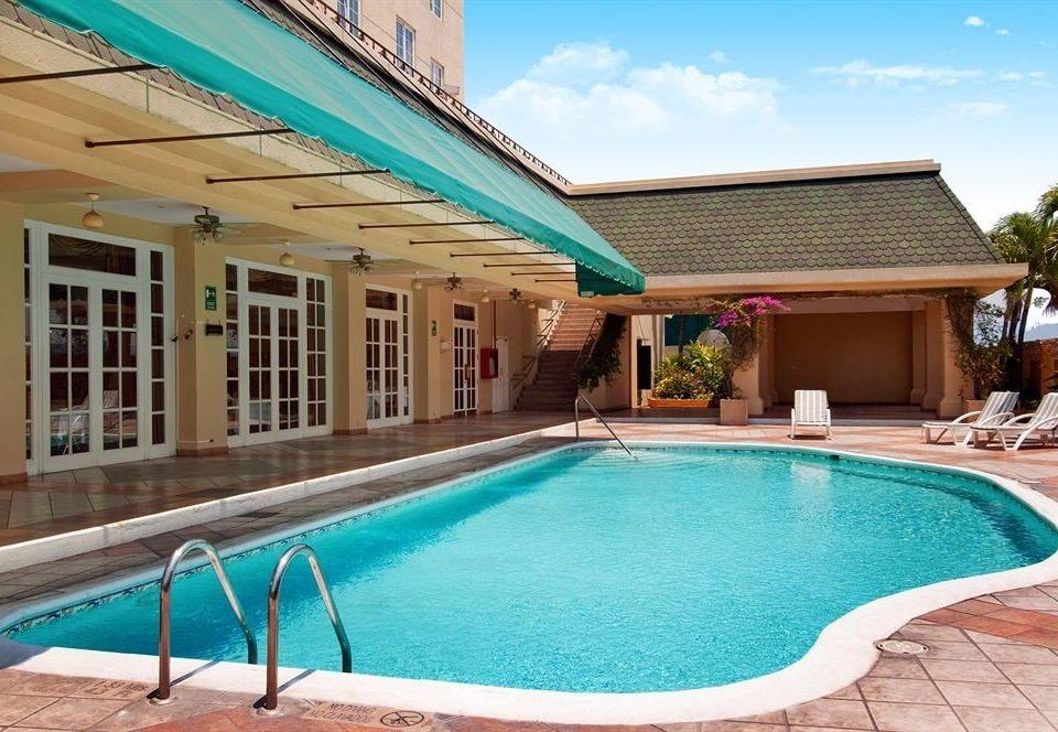Pool building swimming pool property chair Resort blue Beach leisure Villa backyard home swimming condominium mansion empty
