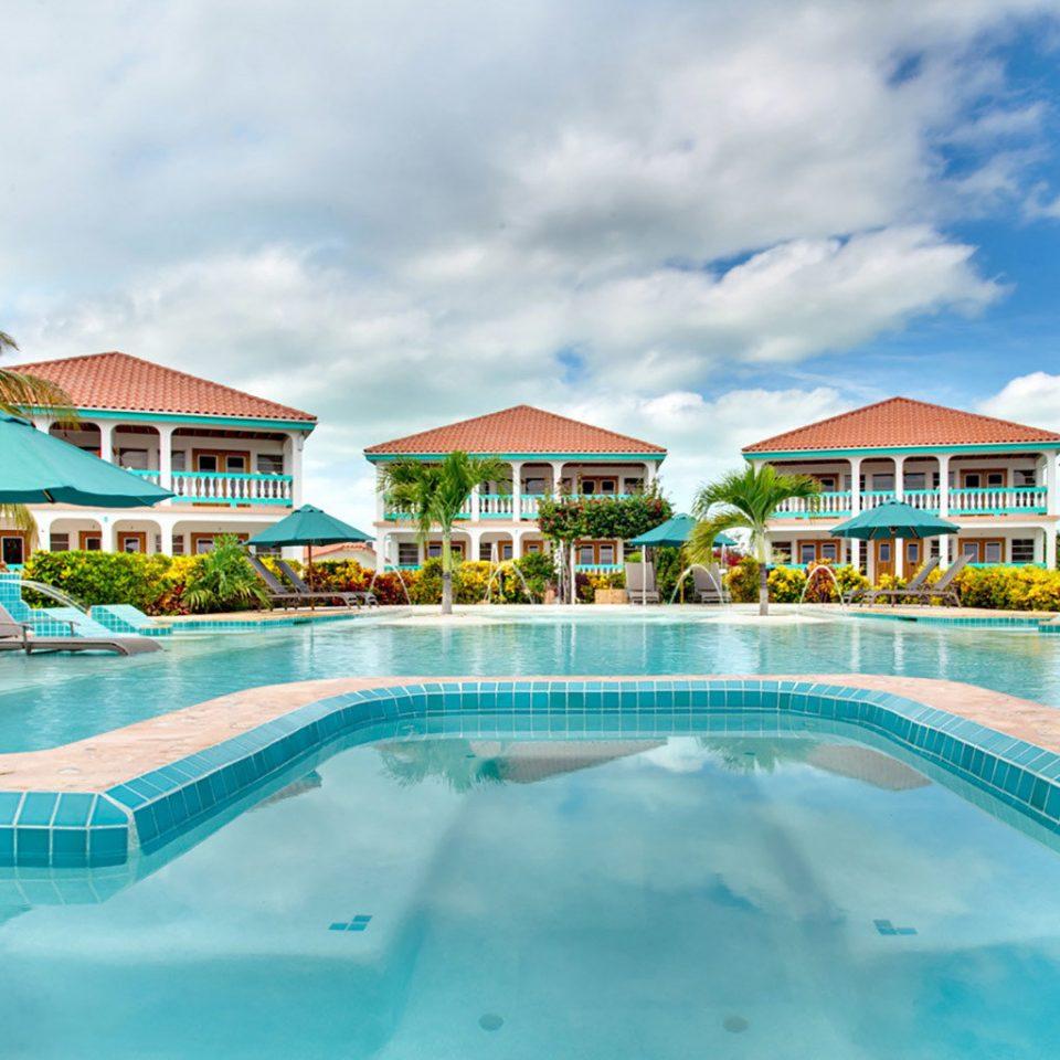 sky umbrella Pool chair swimming pool Resort leisure building Beach blue lawn caribbean Water park resort town amusement park swimming