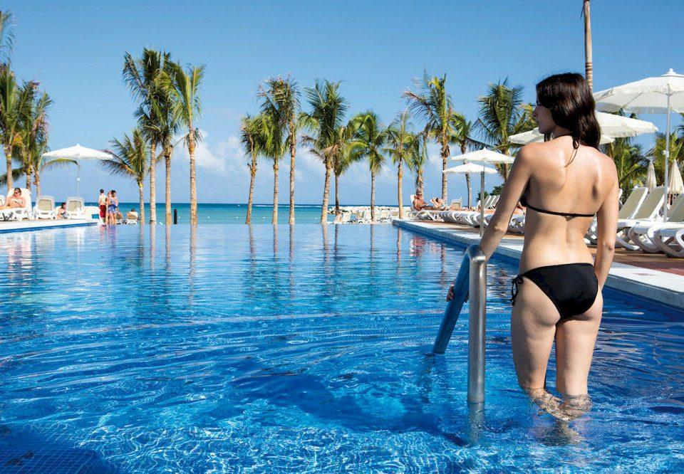 water sky leisure swimming pool woman Beach Sea board Pool swimsuit swimming Water park caribbean beautiful palm