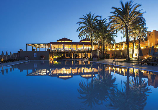 sky water Resort swimming pool marina light arecales evening dock Beach palm dusk palace lined day