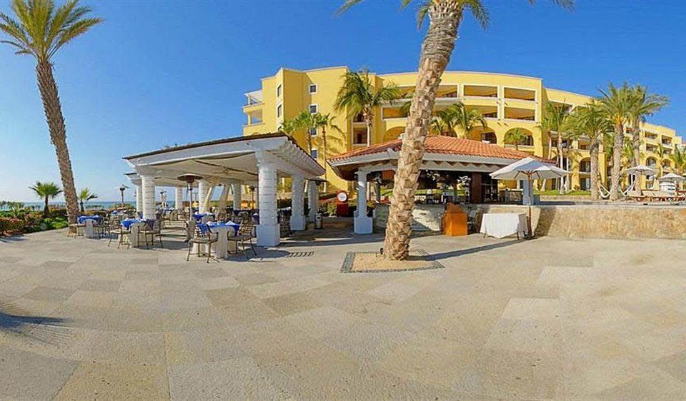 sky ground property building Resort walkway Beach plaza boardwalk palm shore day