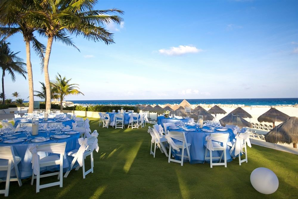 sky tree leisure Resort Beach wedding ceremony tent shore palm lined