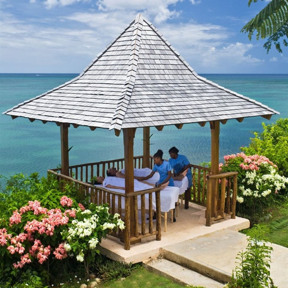 water sky umbrella chair Resort walkway outdoor structure Beach gazebo swimming pool cottage lawn plant shade pretty
