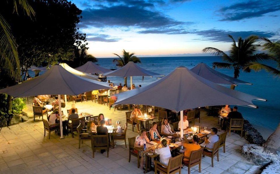 tree umbrella water chair Resort Beach restaurant set enjoying lined swimming