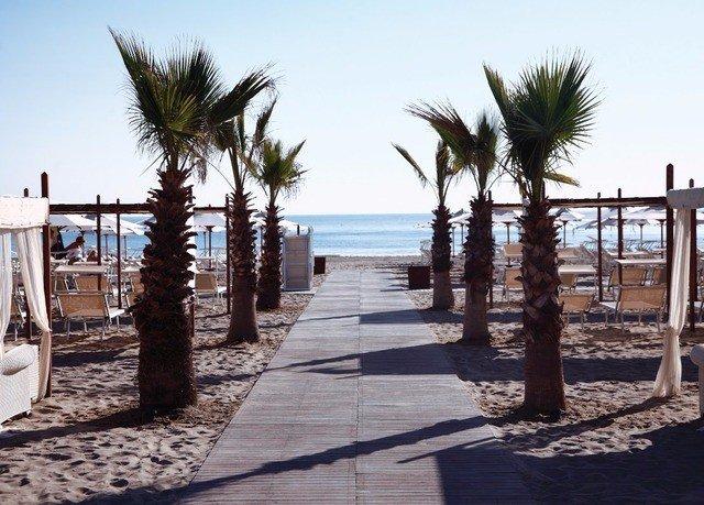 sky ground palm Beach walkway property Resort boardwalk tree arecales sandy dock Sea marina plant shade lined shore