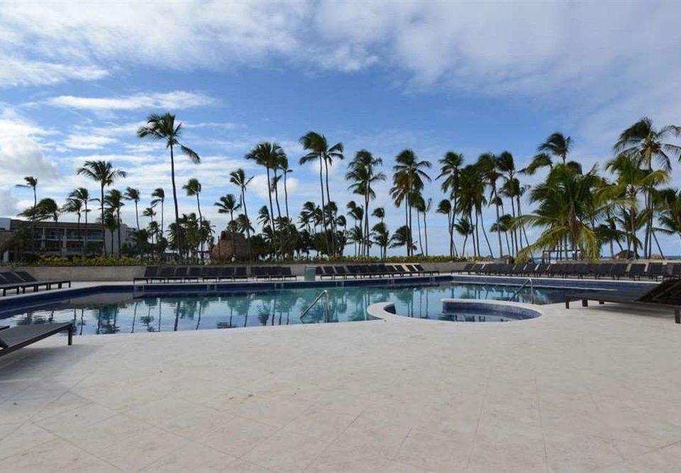 sky ground property building walkway Beach Resort swimming pool Sea boardwalk marina arecales dock caribbean palm sandy