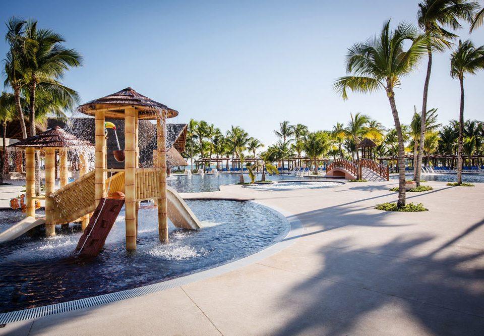 sky tree ground leisure Beach Resort walkway swimming pool palm arecales boardwalk Sea