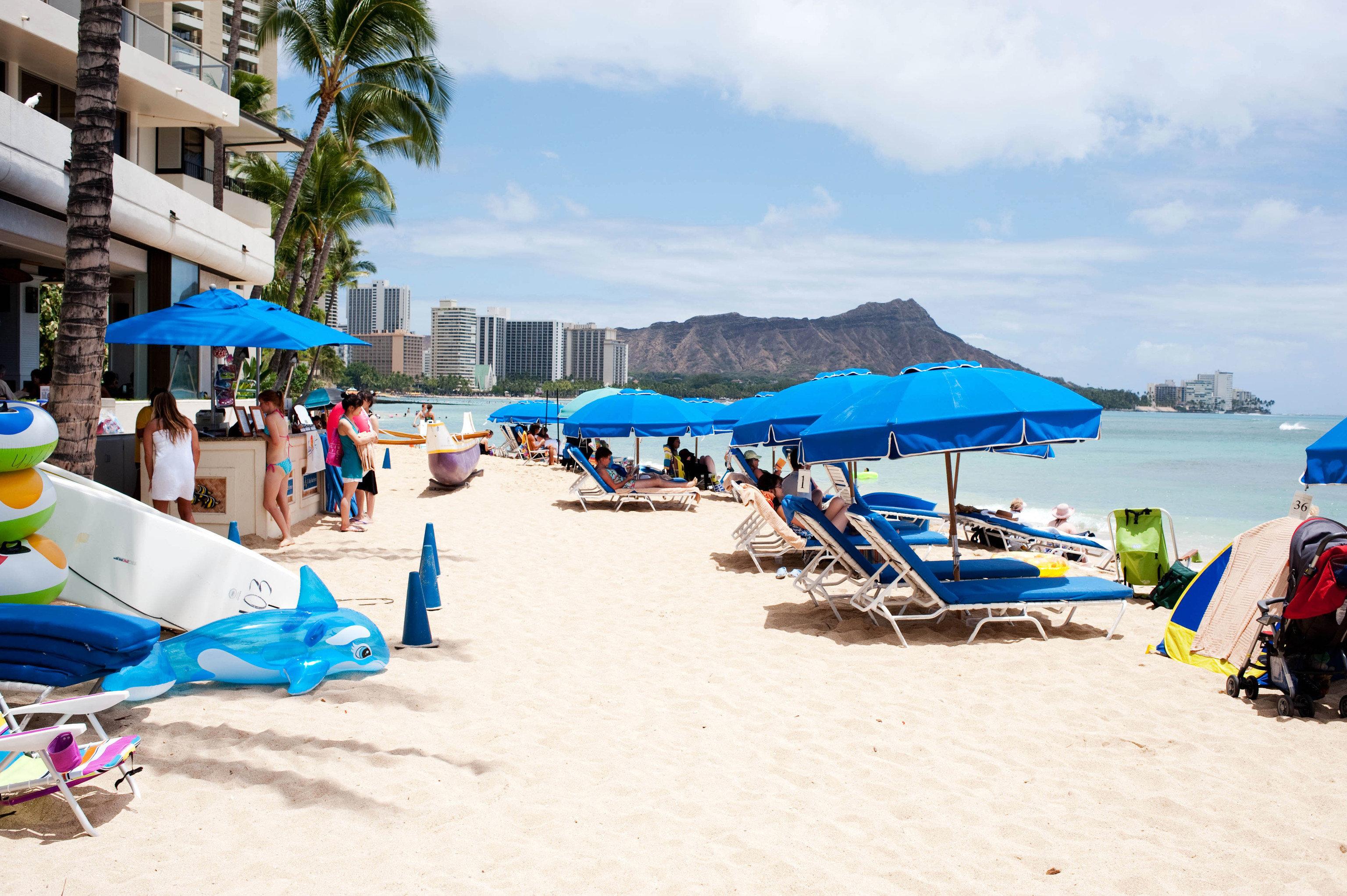 Beach ground umbrella leisure Sea Resort shore blue caribbean lined day enjoying sandy shade