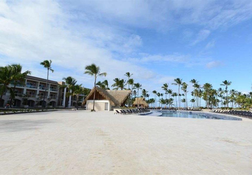 sky ground Beach property walkway Resort Sea boardwalk shore sandy day