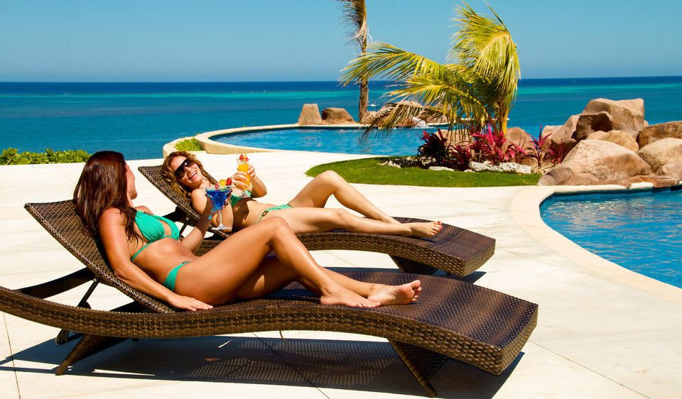 sky water leisure clothing sun tanning swimming pool caribbean Sea Beach sitting photo shoot Resort