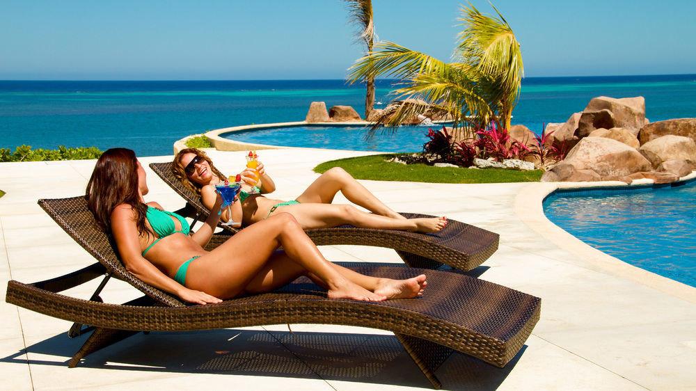sky water leisure clothing sun tanning swimming pool caribbean Sea Beach sitting photo shoot Resort