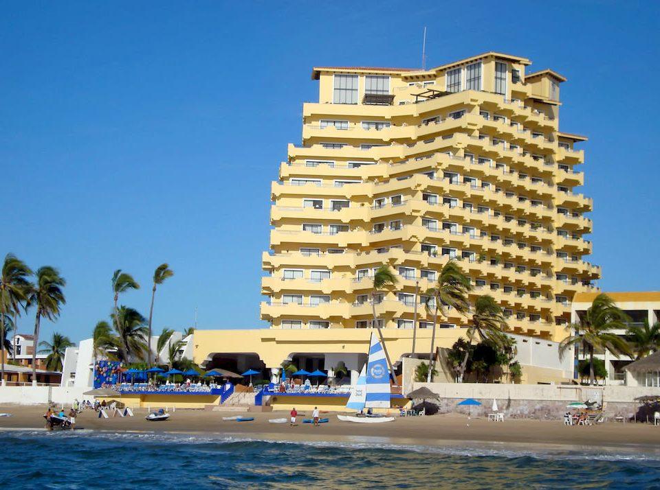 sky Resort Beach marina condominium dock vehicle tower Sea palace palm lined sandy shore