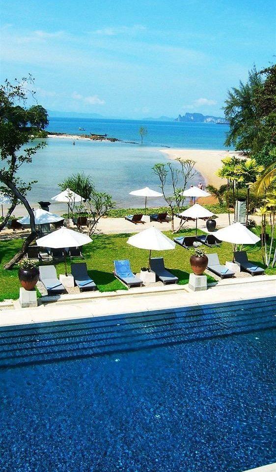 water tree swimming pool property Resort residential area home Beach Sea overlooking marina condominium Villa