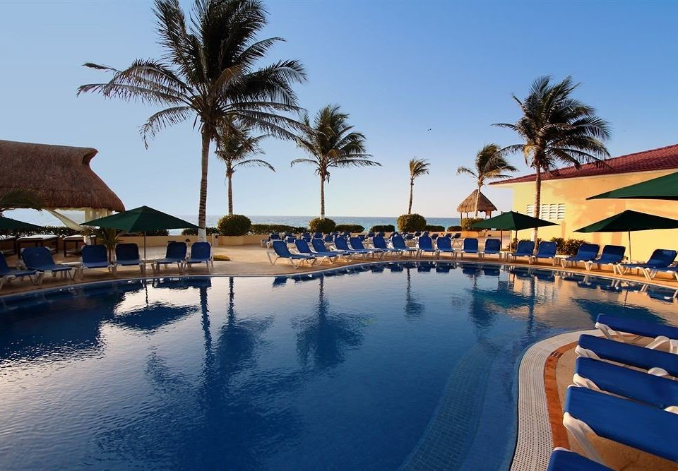 sky water tree swimming pool Resort Beach Sea arecales Villa palace shore lined surrounded