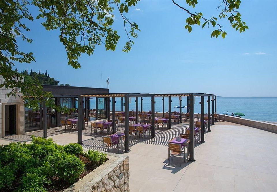 sky tree leisure property walkway Beach Resort home Villa condominium Sea boardwalk cottage palm shore