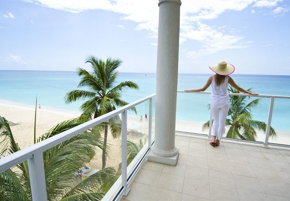 sky property building caribbean Beach arecales Villa home Resort condominium Sea palm porch colonnade