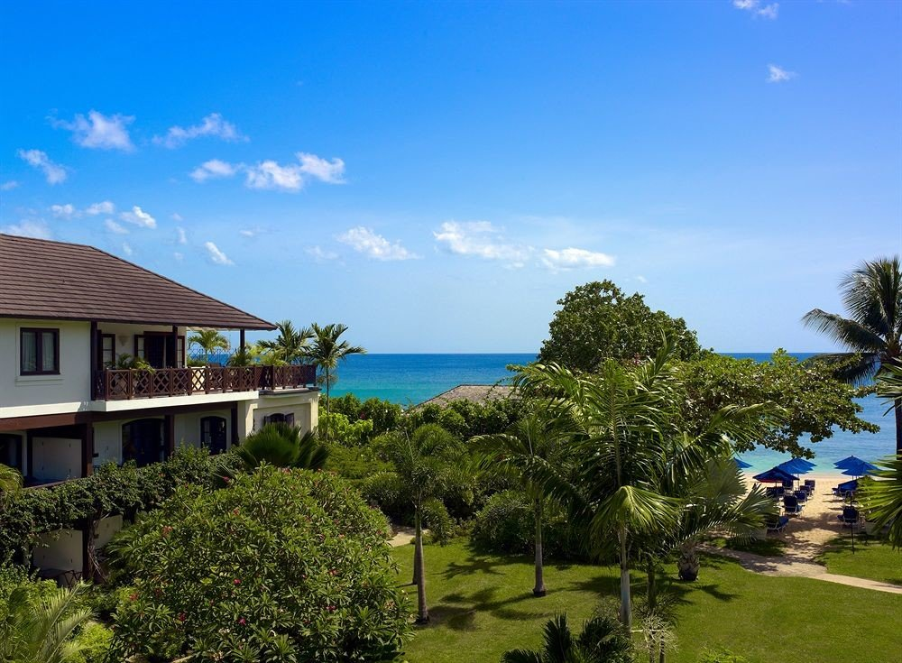 tree sky grass property Resort house residential area home Villa Beach caribbean Sea Village mansion shore lush