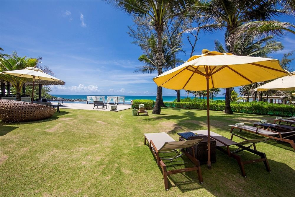 tree umbrella chair grass lawn leisure property Resort accessory Beach Villa shore eco hotel set caribbean cottage lined shade day